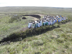 Bags of peat near 'Allt Fhuagro' ready for lift home