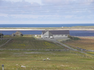 Barvas Free Church Manse with Loch Mòr Bharabhais in the background
