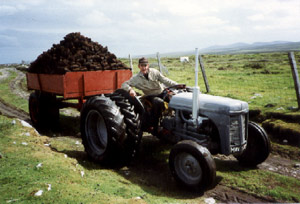 Donald MacDonald (Dòmhnall Uilleam Aonghais Chailein), 5 Upper Barvas, taking home a load of peats with tractor from Upper Barvas moor.